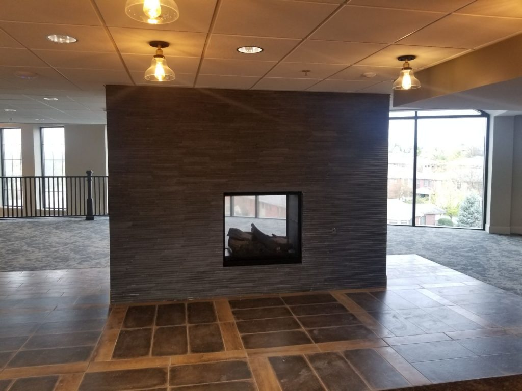 Large grey fireplace in common space